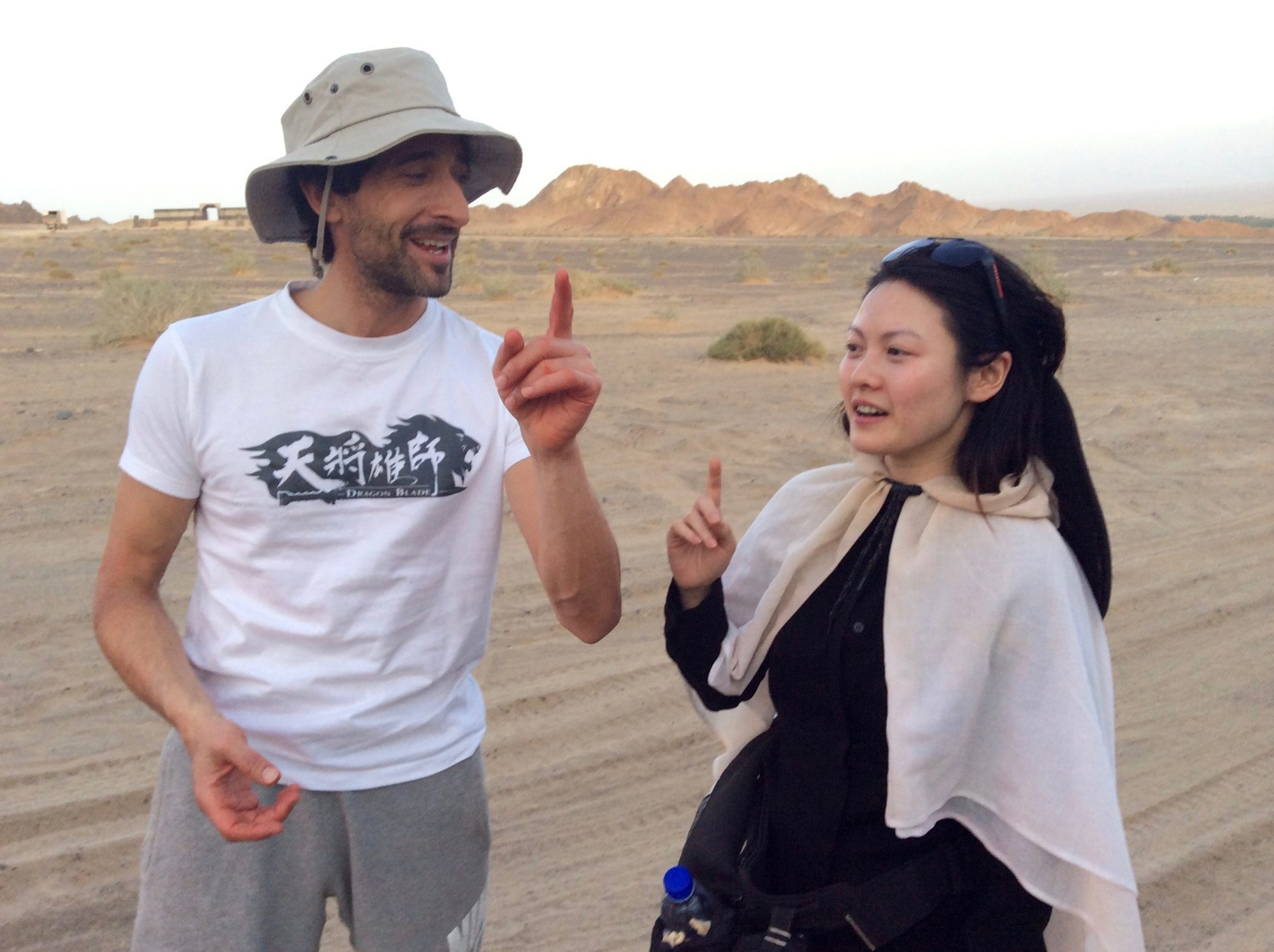 Jenny Wu Adrien Brody Dragon Blade Singing in Gobi Desert